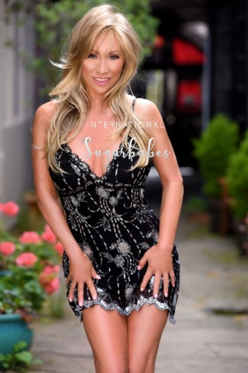 British mature escort Louise in black and silver dress