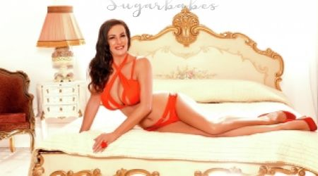 Mature escort Nancy laying on bed
