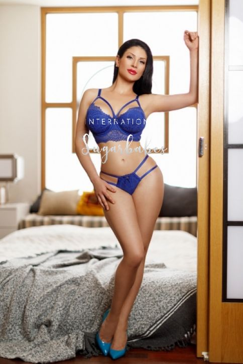 Young escort Evelyn in blue lingerie
